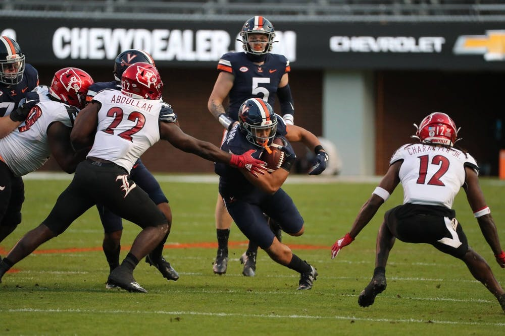 <p>Senior running back Wayne Taulapapa and the Cavaliers will look to knock off a Louisville team that has had its fair share of nailbiters this season.</p>