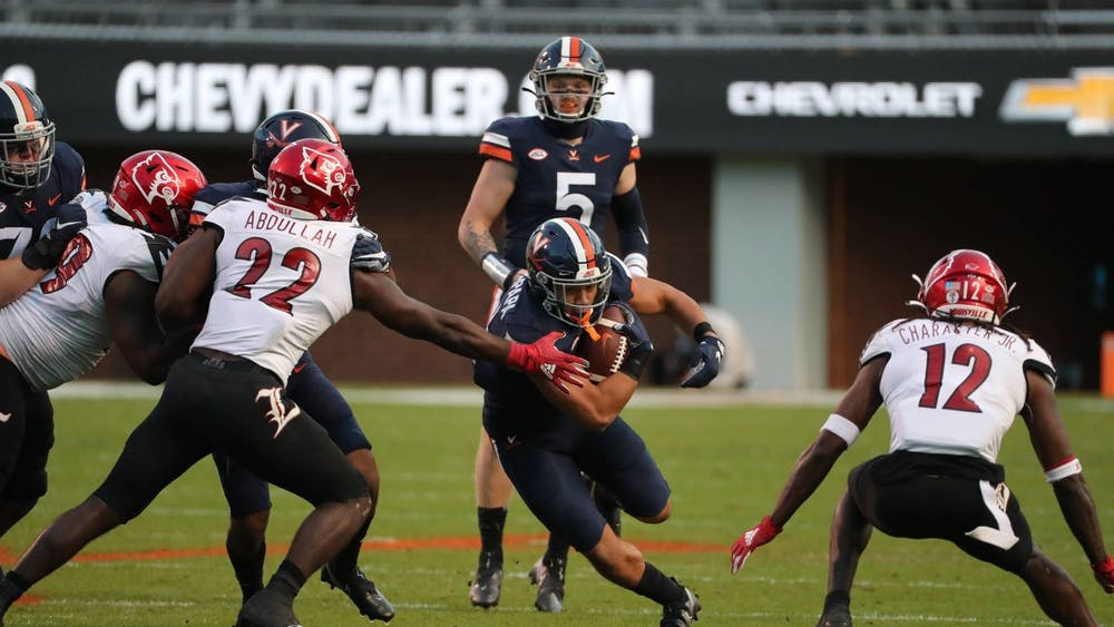 Senior running back Wayne Taulapapa and the Cavaliers will look to knock off a Louisville team that has had its fair share of nailbiters this season.