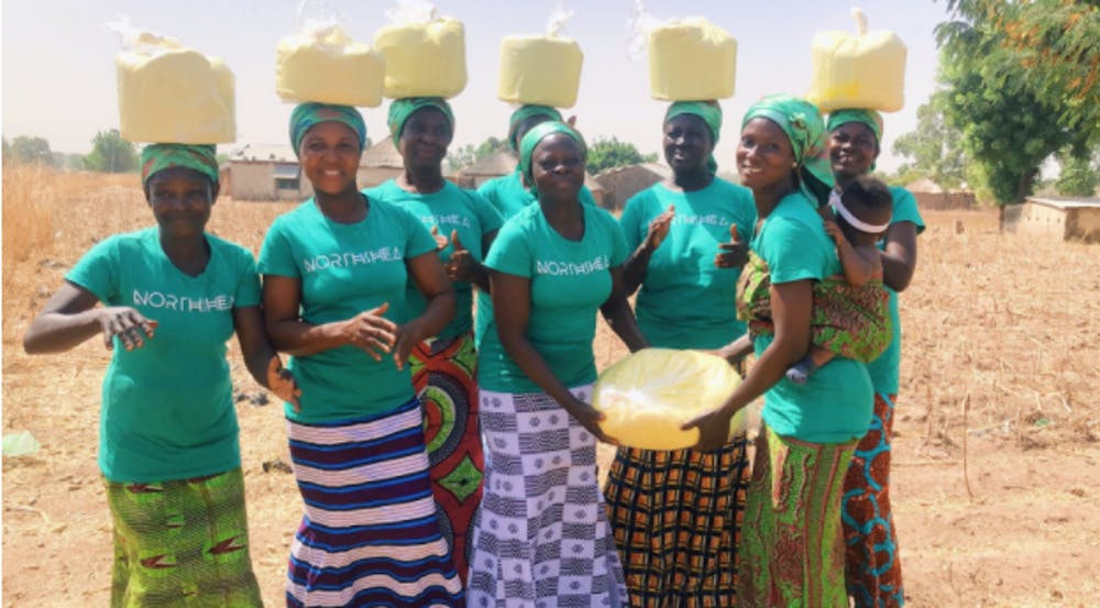 <p>Ghanian women in the village of Woricambo come together to create shea butter from the nuts of the karite tree indigenous to Africa.&nbsp;</p>