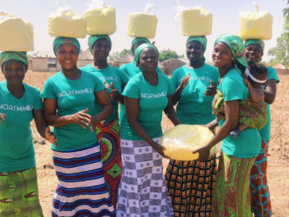 Ghanian women in the village of Woricambo come together to create shea butter from the nuts of the karite tree indigenous to Africa.