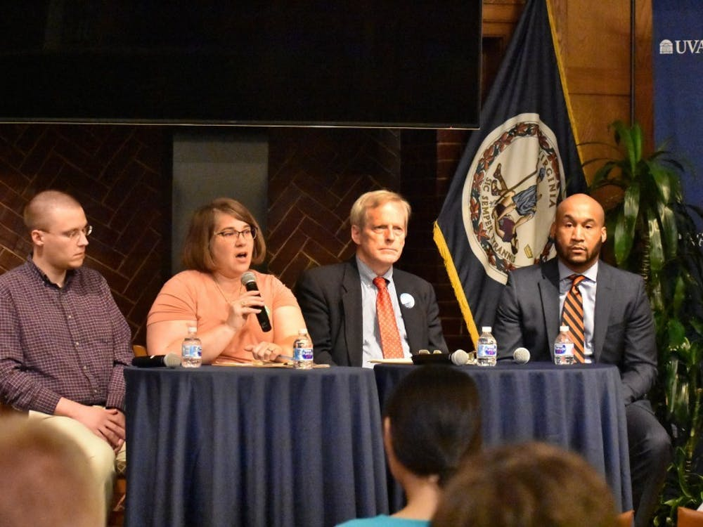 All three Democratic candidates — Michael Payne, Sena Magill, and Lloyd Snook — attended a forum at the University Oct. 25, as well as one Independent candidate, Bellamy Brown.