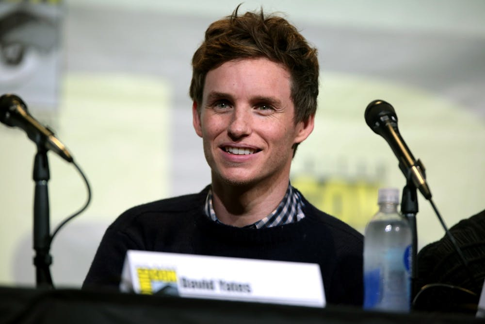 <p>Eddie Redmayne plays Tom Hayden, leader of the New Left's Students for a Democratic Society</p>