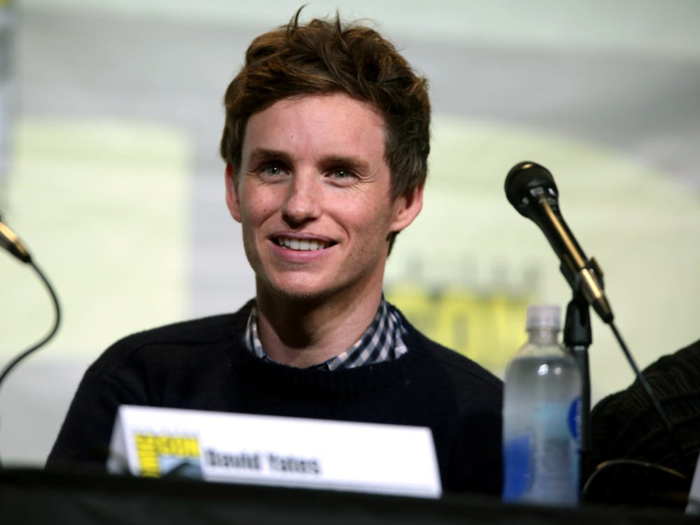 Eddie Redmayne plays Tom Hayden, leader of the New Left's Students for a Democratic Society