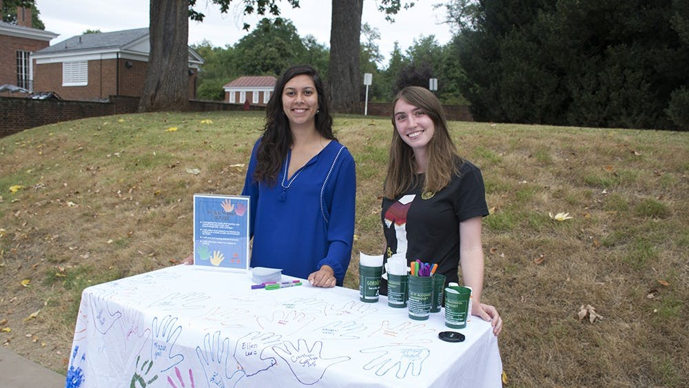 Volunteers manned tables on the lawn all weekfor students to sign the pledge and trace their hands on a banner.