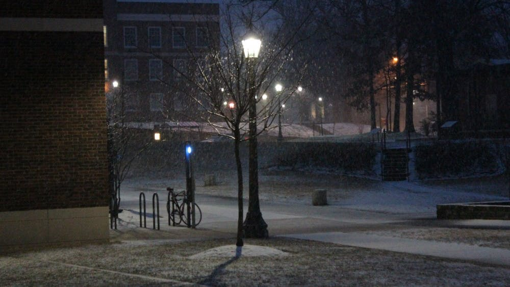 The University announced classes will be cancelled shortly after 6 a.m. Monday, as a wintry mix just begins to accumulate on Grounds in a storm the National Weather Service predicts will leave between 8 and 12 inches of snow by the day's end.