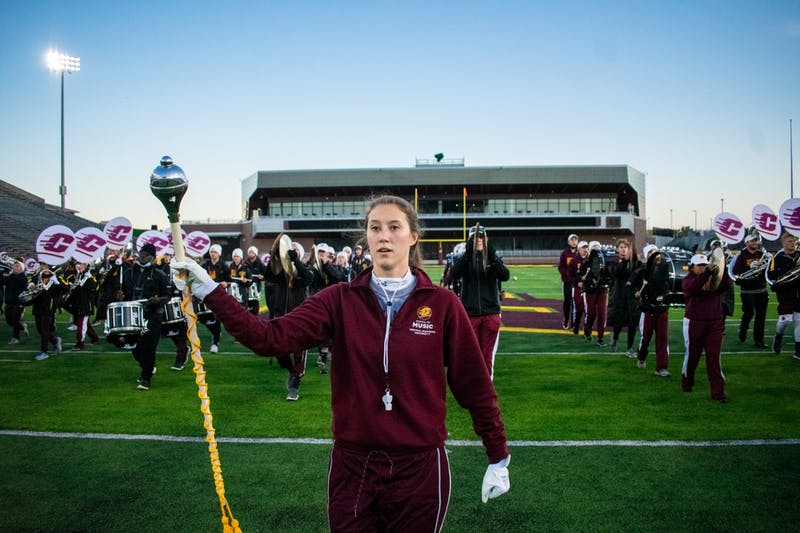 PHOTOS: After COVID-19 took away the crowd, alumna returns to lead the Marching Chips at homecoming