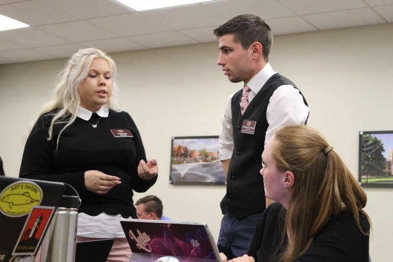 lyndi rose and brandon mcdonald discuss project academic affairs.jpg