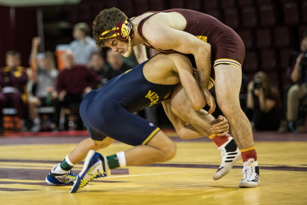 central michigan life wrestling dominated by michigan in season opener