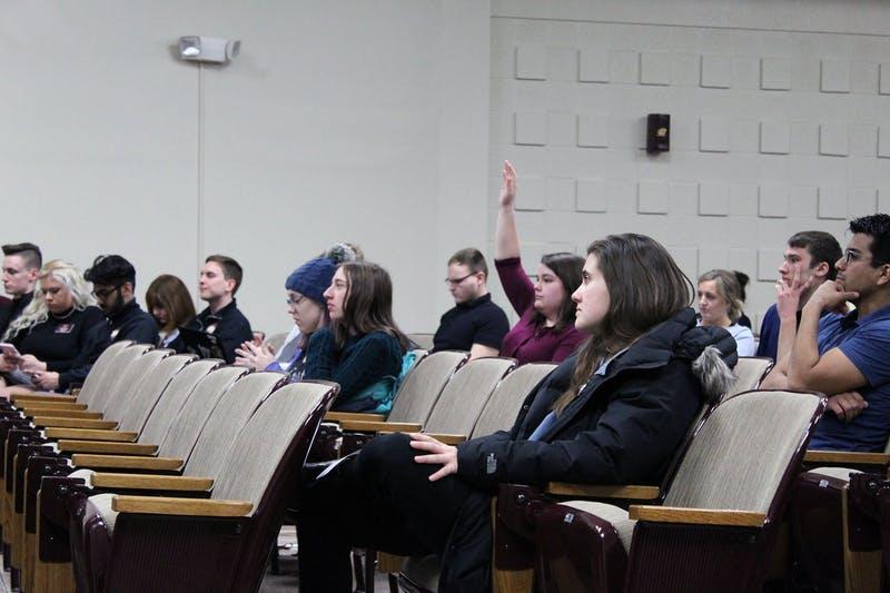 sga representative raises her hand to comment on down under food court sustainable silverware resolution.jpg