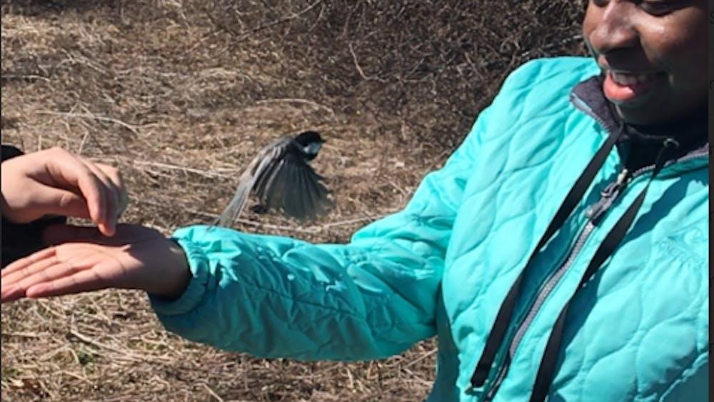 Junior Nataysha Owens releases a bird.