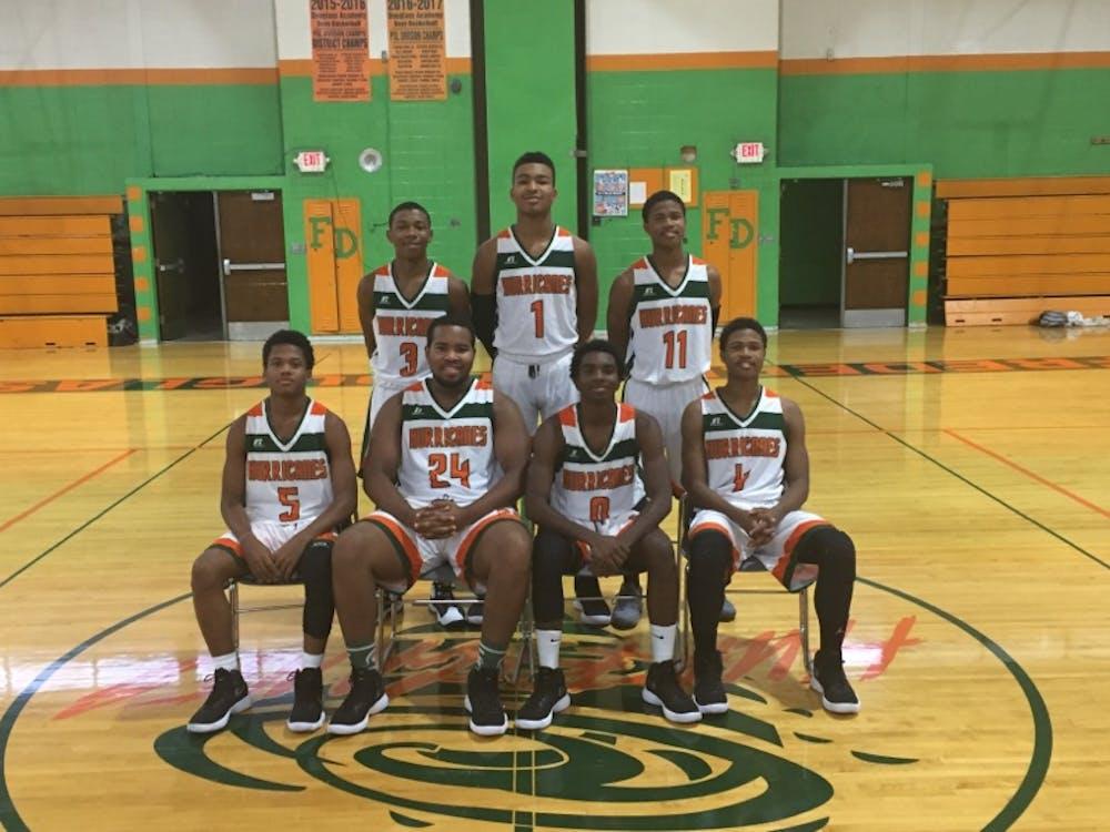 Frederick Douglass's Varsity Basketball team won their first game of the season, 52-51.
