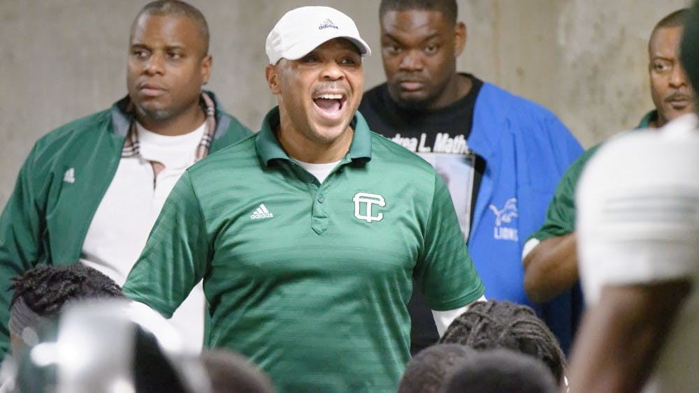 Cass Tech coach Thomas Wilcher addresses his team at Ford Field.