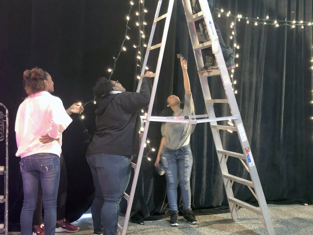 <p>Three Detroit School of Arts students work as stage managers at a behind-the-scenes event for Kamal Smith. Being a stage manager is a job typically stereotypically meant for men.</p>