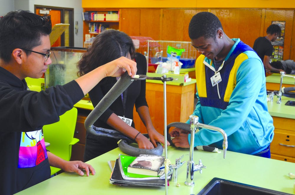 <p>Juniors Javier Martinez, Alissa Perry, and Julius Meadows all show their STEM talent as they configure the rollercoaster.</p>