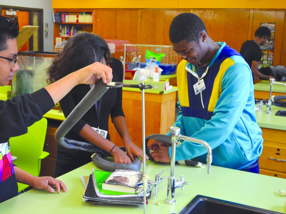 Juniors Javier Martinez, Alissa Perry, and Julius Meadows all show their STEM talent as they configure the rollercoaster.
