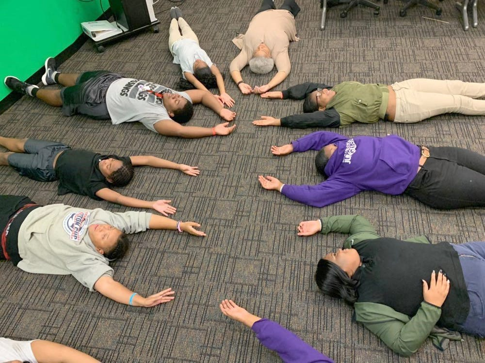 Students and faculty participate in meditation exercises in a new class at Southeastern High School.