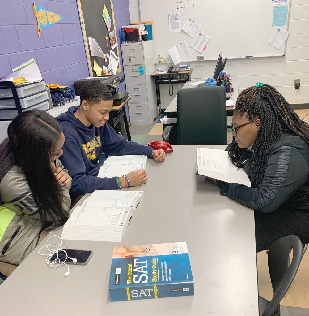 <p>Students prepare for the SAT by reviewing study guides and taking Michael Gaston's test prep class.</p>
