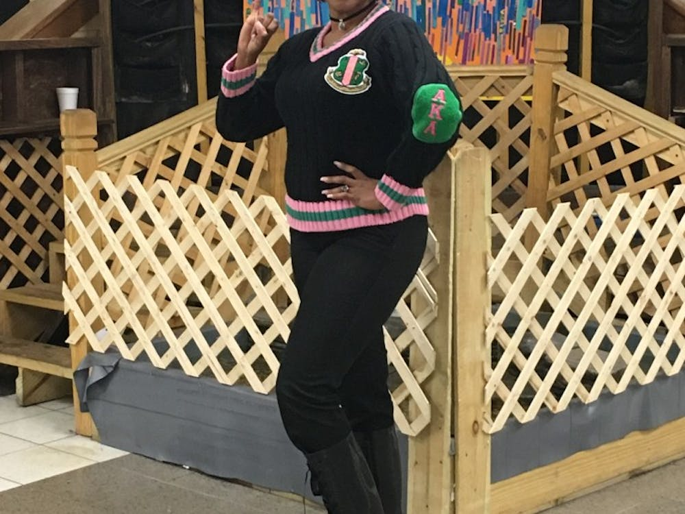 Lisa McMurtry poses in her AKA Sorority gear at East English Village.