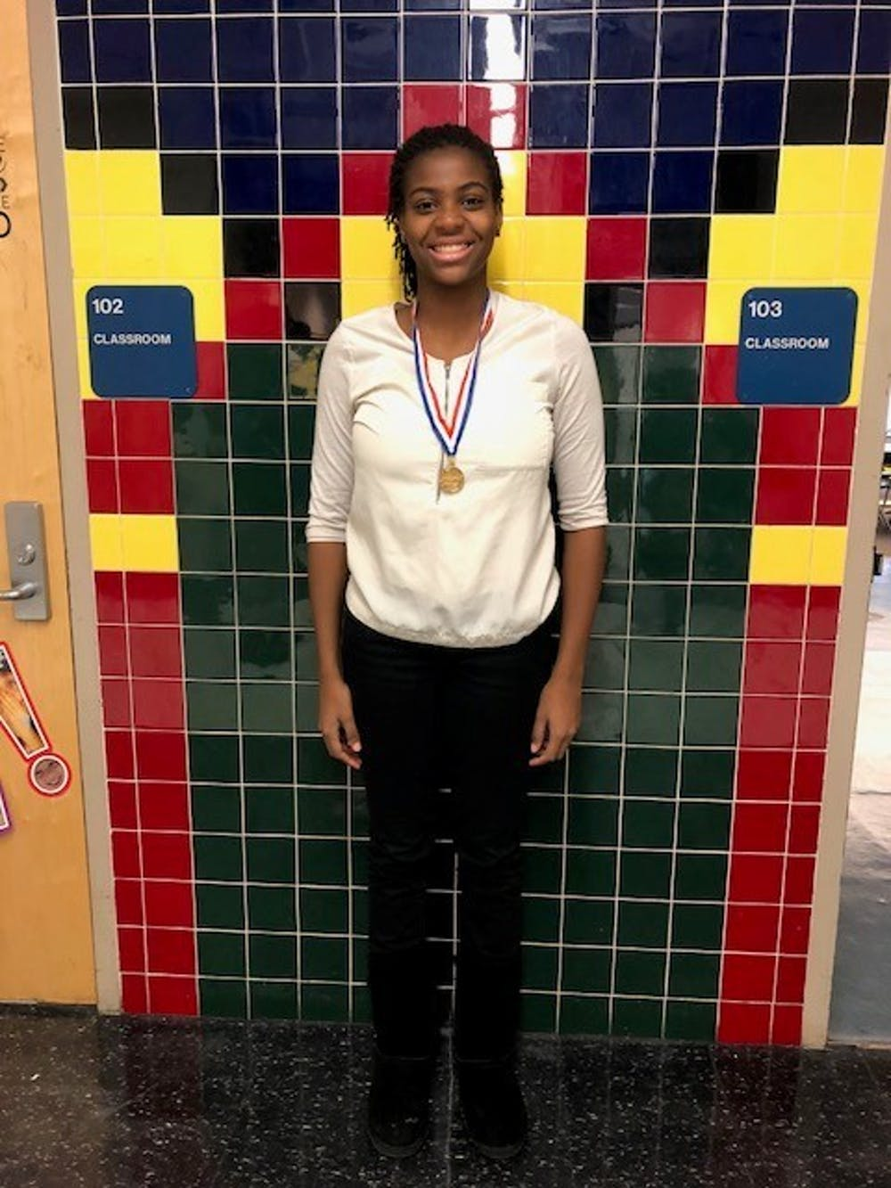<p>Sophomore Makayla Jackson shows off her medal a BPA competition.</p>