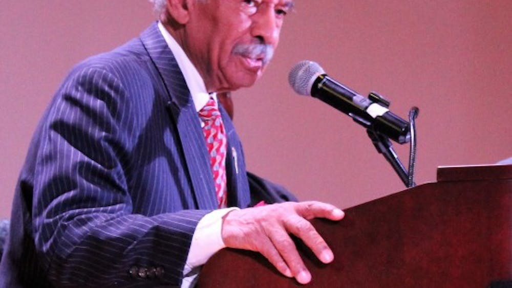 Congressman John Conyers addresses a packed auditorium with words of encouragement about unity for all people.