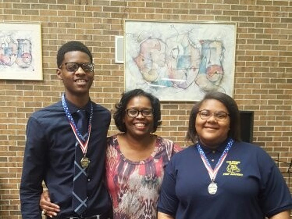 Nikolas Huey and Kharriane Gray pictured with Allayne Woods at a the Palazzo Strozzi Foundation Scholarship Banquet. Woods inspired both Huey and Gray to submit essays for the opportunity to travel to Italy.