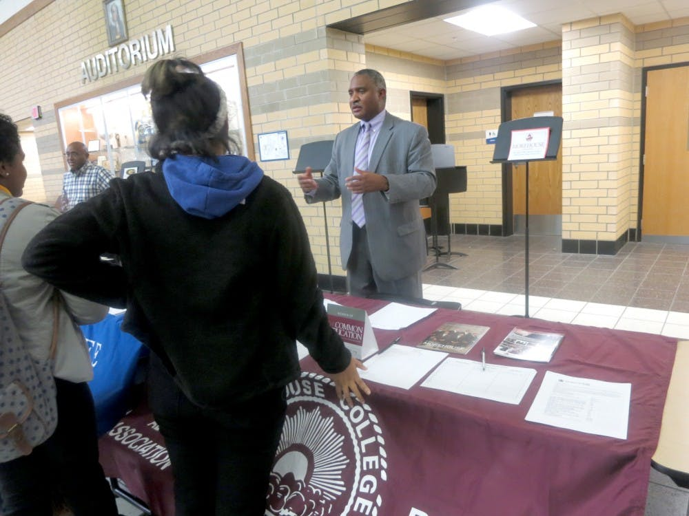 <p>A Morehouse College recruiter speaks to students at an East English Village Preparatory Academy college fair. File photo by Voice of the Ville staff.</p>