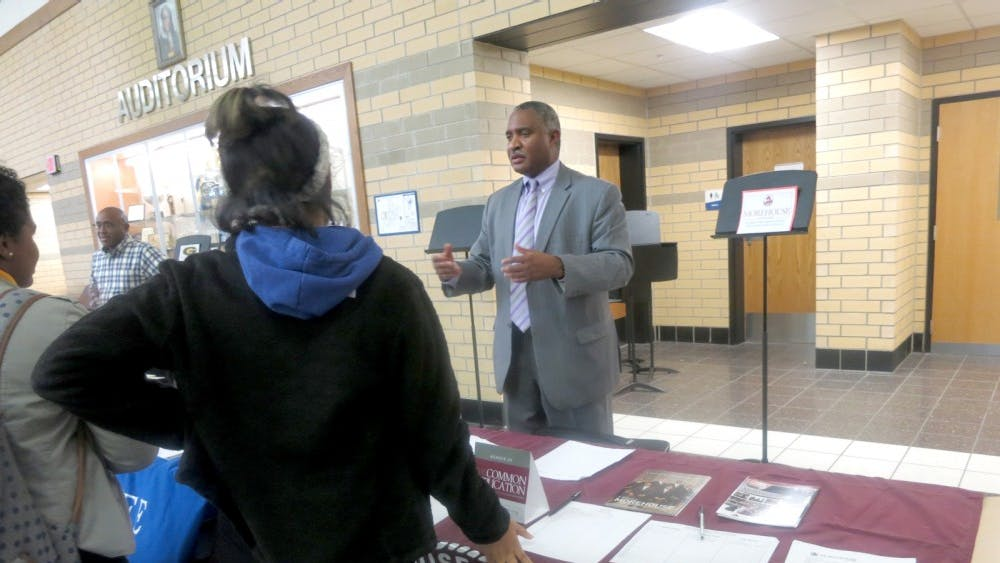 A Morehouse College recruiter speaks to students at an East English Village Preparatory Academy college fair. File photo by Voice of the Ville staff.