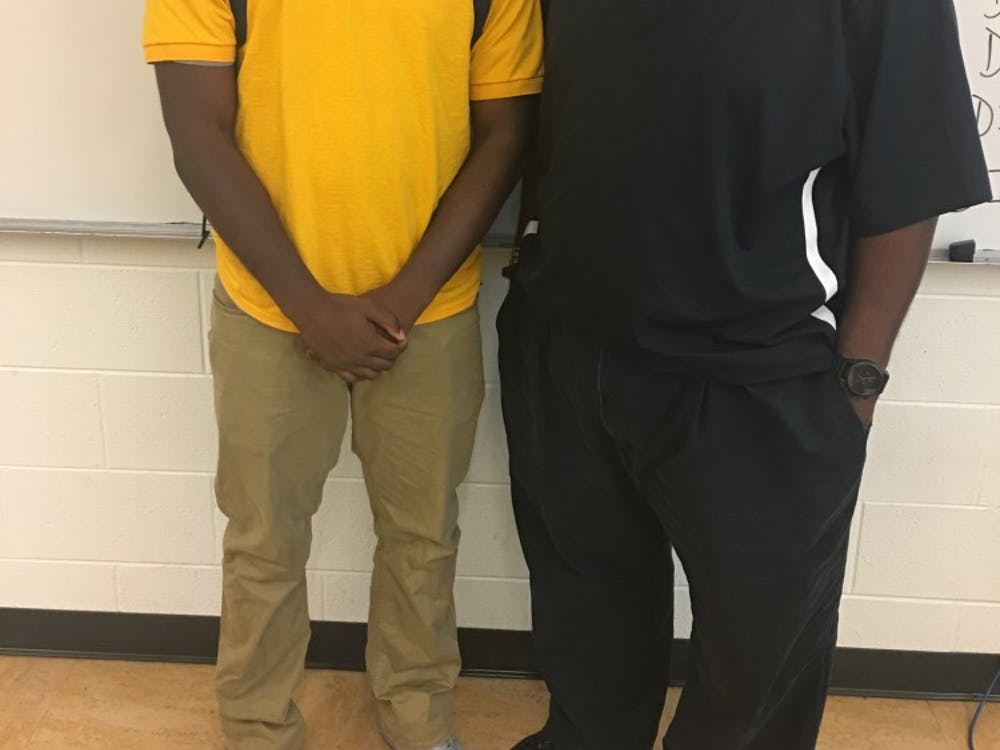 Bryant Brewer pictured with his football coach and mentor Rod Oden.