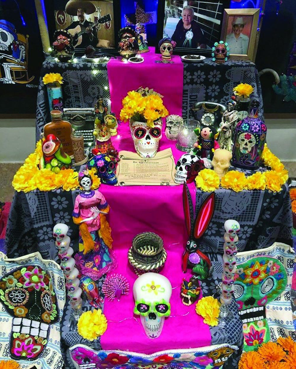 "<p>&nbsp;""Cruz Familia"" was the name of an Ofrenda displayed at the DIA exhibit commemorating loved ones who passed away.</p>"
