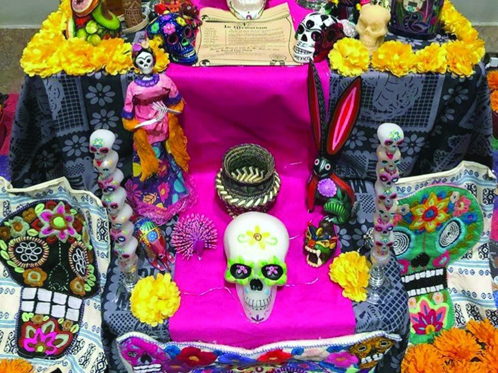 """Cruz Familia"" was the name of an Ofrenda displayed at the DIA exhibit commemorating loved ones who passed away."