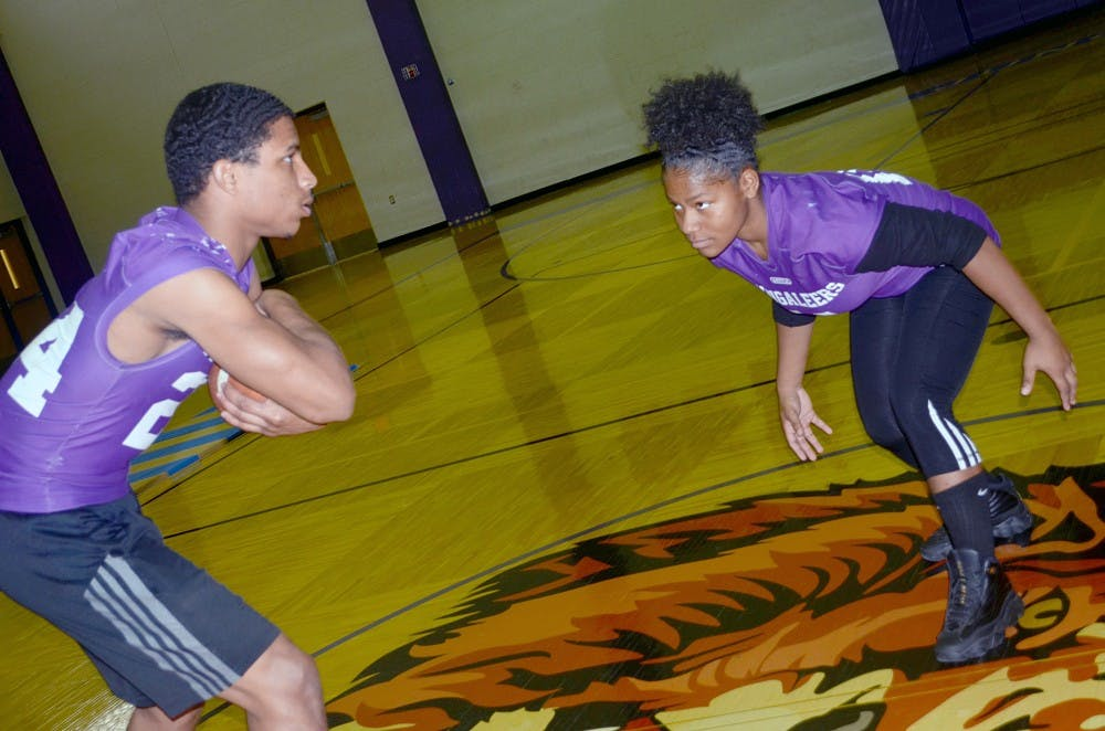 <p>Azia Isaac and teammate Damari Covington-Woods face off in practice.</p>