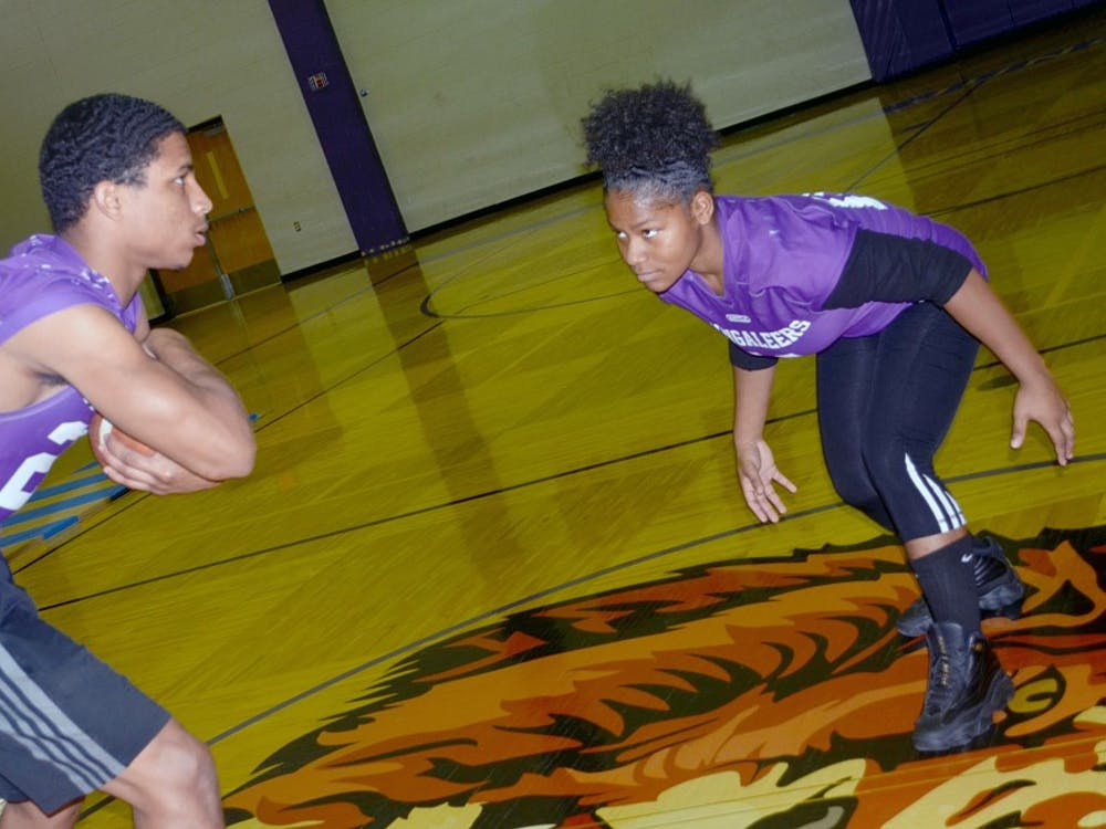Azia Isaac and teammate Damari Covington-Woods face off in practice.