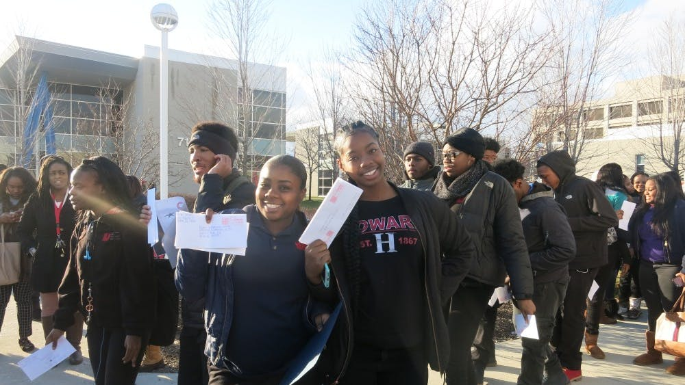 March to Mailbox Uprep seniors Shelbi Smith and Anayah Gorman march to mail their college applications.