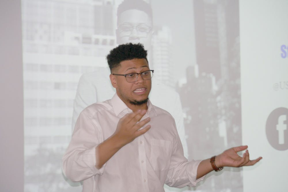 <p>United Nations Youth Observer Jay'len Boone talks about his job and his background at Mumford on Feb. 7. Boone met with the leadership of the student councils from all of the Detroit high schools and stayed on to meet with Mumford's student council. Photo by Logen Merritt.</p>