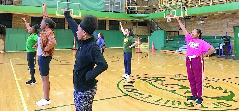 <p>Sophomore Nick'Kel Bridges, freshman Summer Evans-Reynolds, freshman Trinity Walker, senior Isabel Lopez, freshman Anyelina de la Cruz, and sophomore Nia Masud at cheer practice. Photo by Liz Sanchez.</p>