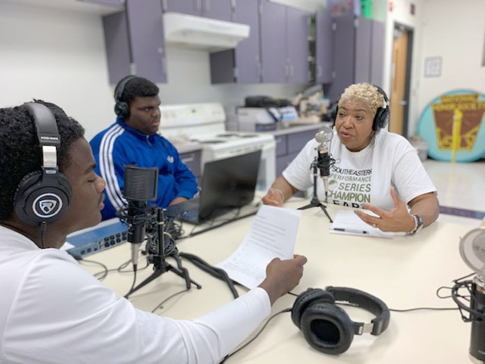 <p>Journalism students interview Southeastern counselor Bettye Foster.</p>