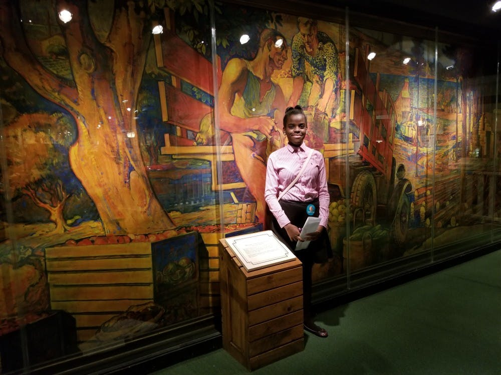 <p>Freshman Ashley Williams enjoys the artistry at the Michigan Historical Museum.</p>
