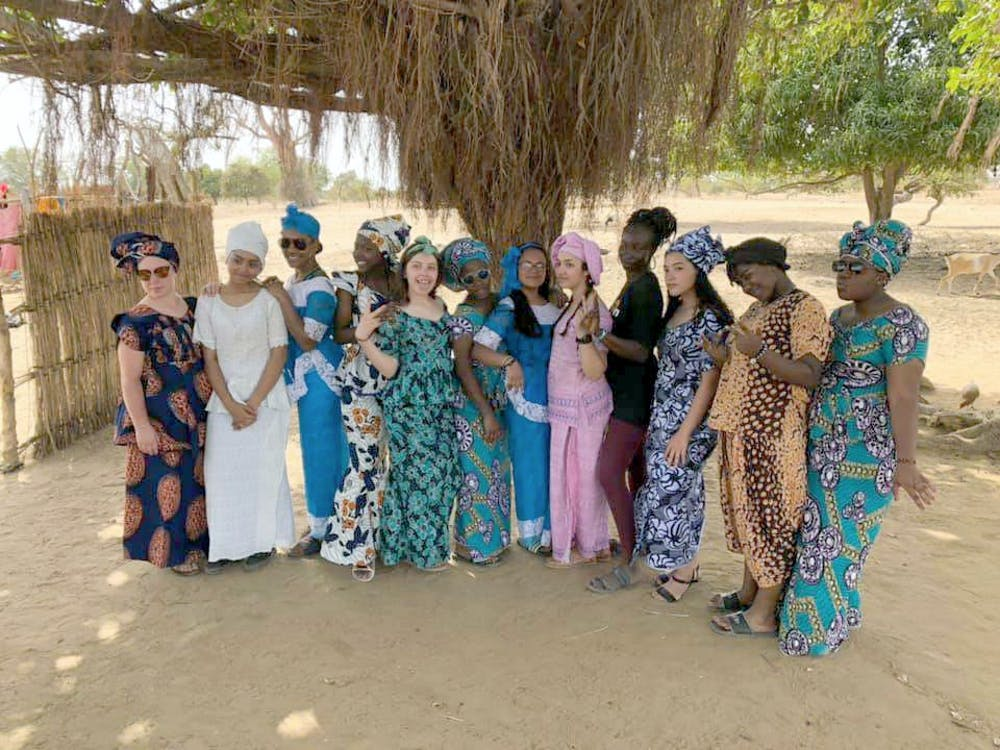 <p>The buildOn trek team poses for a photo before the farewell dance from the village of Deffame, Senegal, West Africa, in April. Courtesy photo.</p>