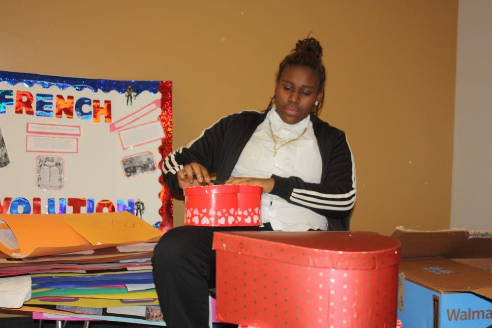 <p>Student Government Senior Erica Pruitt preparing gifts for the Valentine's Day promotion.</p>