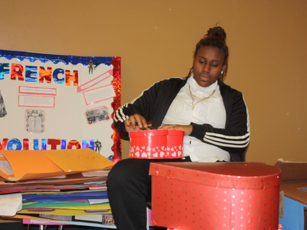 Student Government Senior Erica Pruitt preparing gifts for the Valentine's Day promotion.