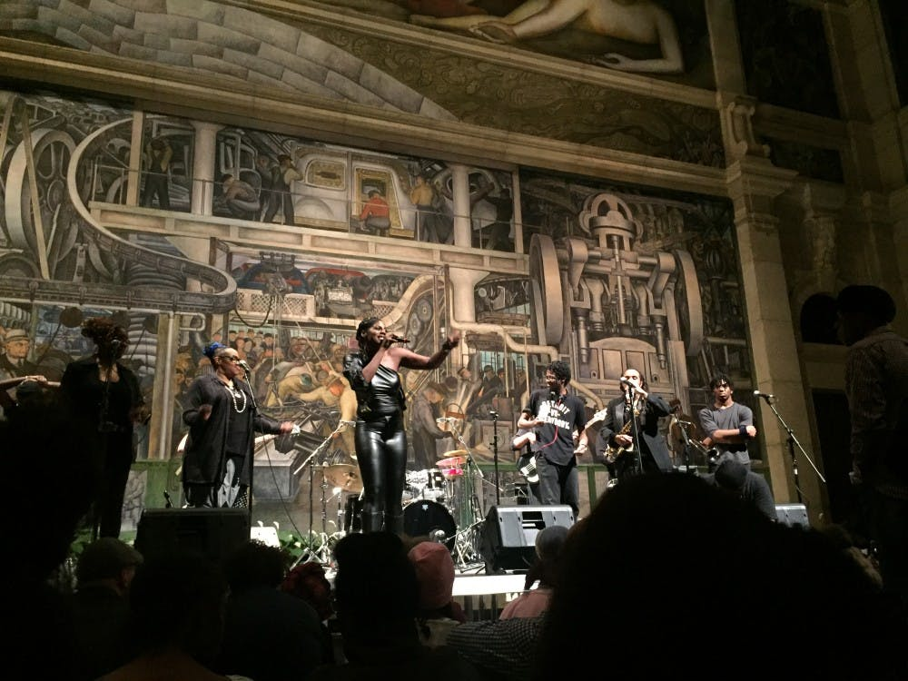 Mahogany Jones performing at the Detroit Institute of Arts with her live band.