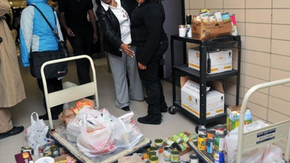 CMA vice principal Cox and students gather canned goods for the less fortunate.