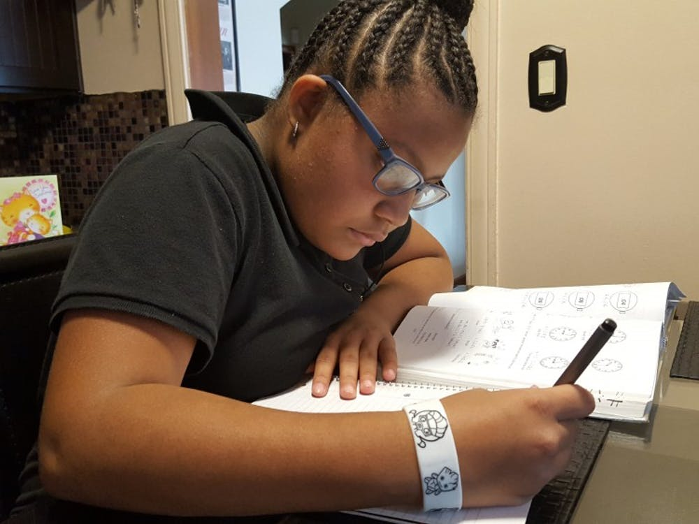 Foreign Language Immersion student Anaya Smith completes her Japanese homework at the kitchen table.