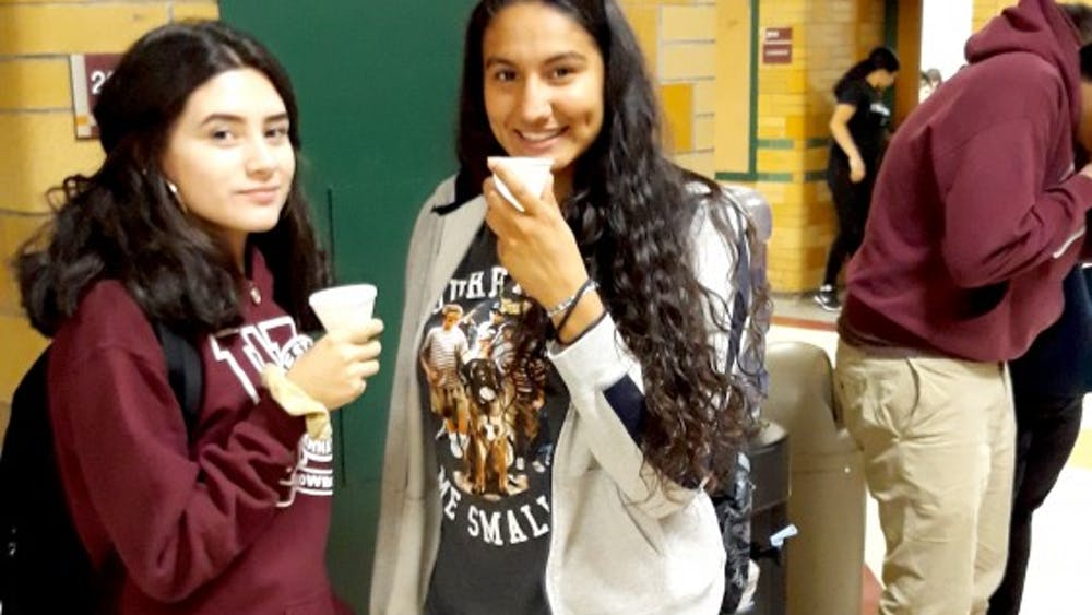 Sophomores Ceslia Galindez and Frida Diaz stop to grab a drink at one of the many water coolers available in the halls of Western.