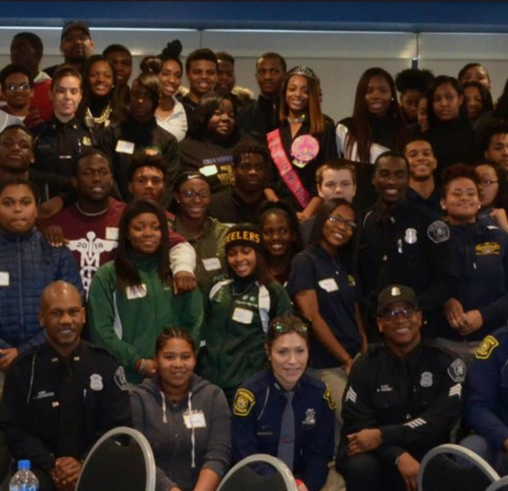 <p>The future of tomorrow were asked to take a picture with the DPD Officers.</p>