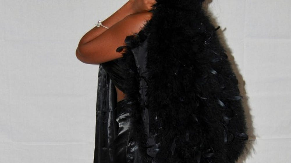 Aaniya Carroll, owner of Amor Coutur, poses for a photo shoot of her fashion line.