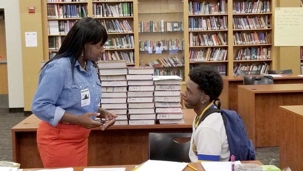 Detroit Parent Network Mrs. Mitchell shares with SE Junior Antonio Preston.