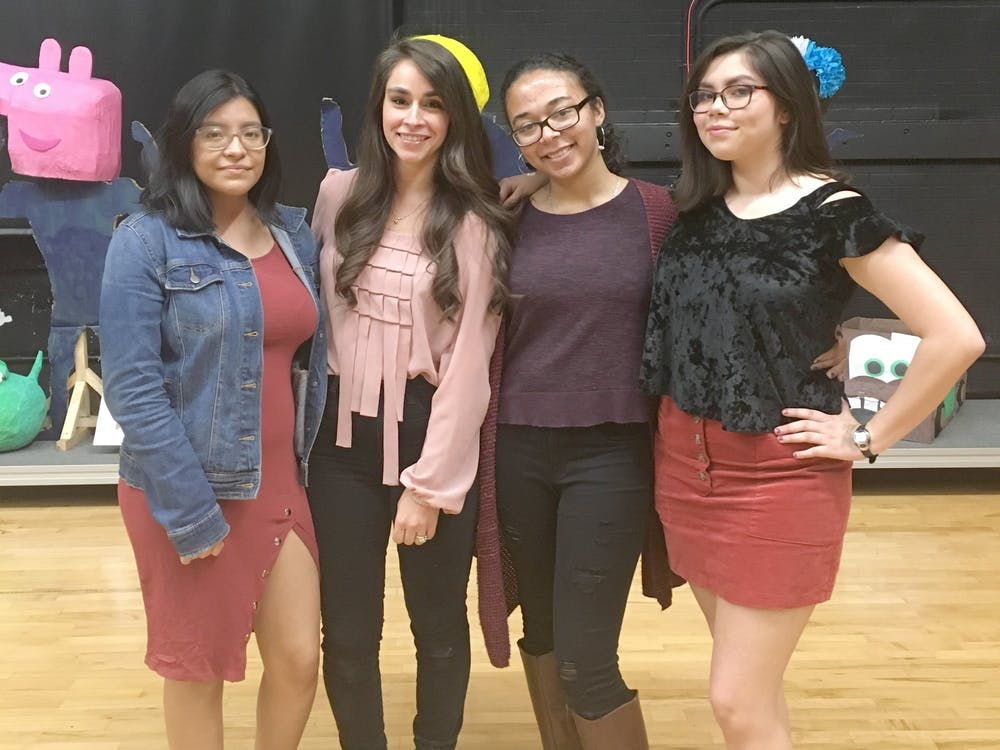 From left to right, student artist Marleen Piña, Western art teacher Kathleen Dickinson, student artists Eleanor Aro and Vanessa Ybarra. Photo courtesy Leonardo Eniquez.
