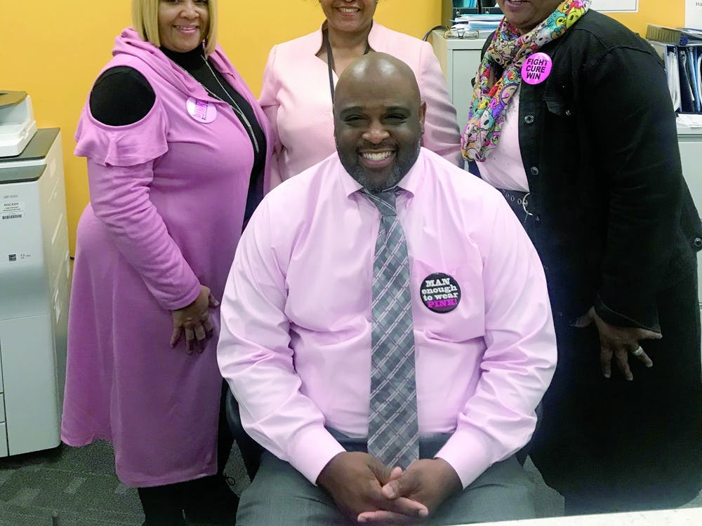 East English Village principle Dr. Larry Gray, seated, and his administrative staff participated in Pink Out Day on Oct. 14.