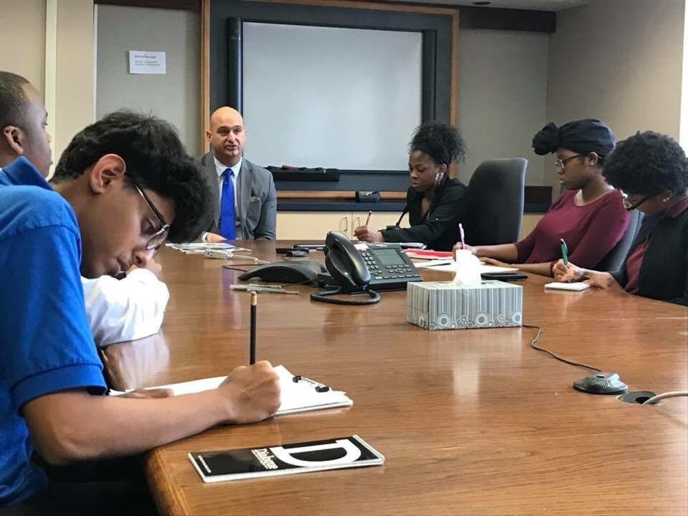 Osama Aldahan, reporter for the Benjamin Carson Diagnostic, and other Dialogue reporters take notes while interviewing Superintendent Vitti.